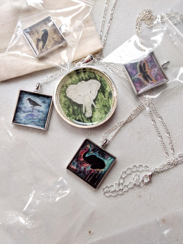 several artistic animal necklaces made by Jeffcoat Art