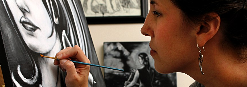 Artist painting a black and white canvas- Jeffcoat Art