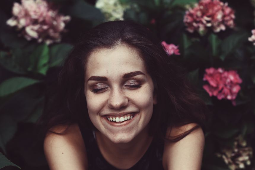 woman smiling in garden 7 Quick Ways to Get Inspired