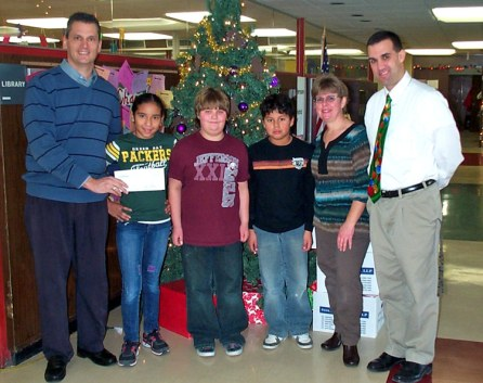Garden Project – West Elementary School -- Representing Jefferson Community Foundation, Eric Felth, (left) presents a check for $500 to Vicki Schamens, after school science coordinator, Mike Howard, Principal West Elementary School, and 5th grade students directly involved with the project. The students are Karen Lanza, Allie Gilbert, and Issac Estaban-Lopez.