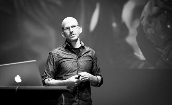 Jeff Gothelf presenting on stage