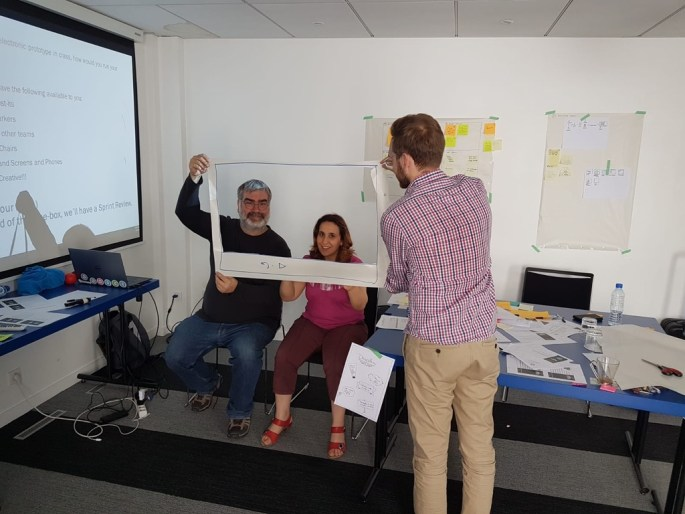 3 people in an office building a paper prototype