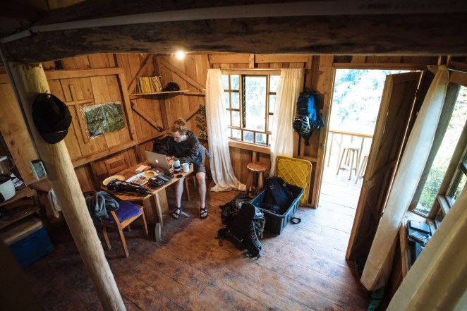 Logan Nelson editing at the Martinez family cabin