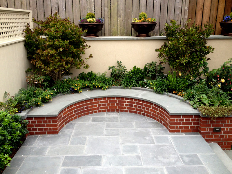 blue stone patio curved bench
