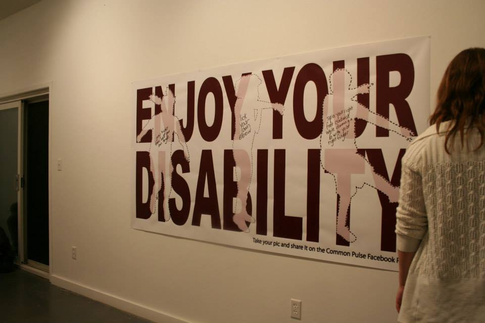 """""""Enjoy You Disability"""" banner posted in the Durham Art Gallery"""