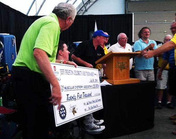 John Davidson and Jeff Preston preparing for the $25,000 cheque presentation