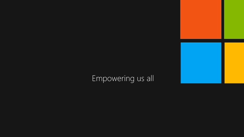 """Black background with centered white text stating """"Empowering us all"""". Microsoft 'window' logo in the top right corner"""