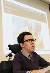 """Jeff delivering a presentation entitled """"Communication Through Meme"""""""