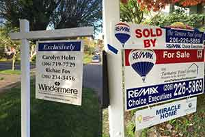 two-for-sale-signs