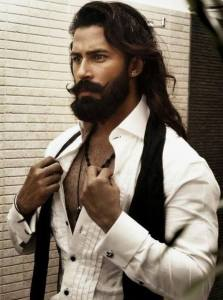 Photo of very sexy muscular man with handlebar mustache, beard and long hair.