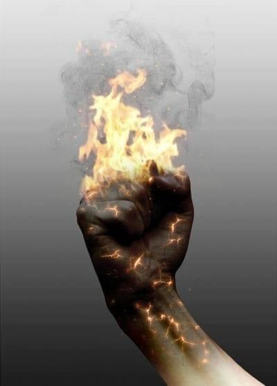 Image of a raised fist enveloped in fire