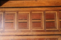 Inlaid wood floor in smoking room.