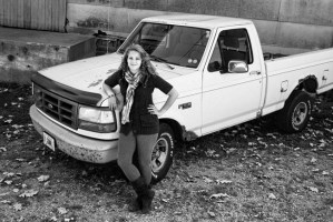 Cassie stands in front of her prized truck