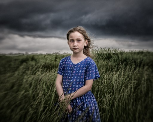 My daughter against a moody sky.