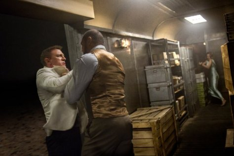 James Bond (Daniel Craig) and Mr. Hinx (Dave Bautista) battle it out as Madeleine Swann (Léa Seydoux) looks on in Metro-Goldwyn-Mayer Pictures/Columbia Pictures/EON Productions' action adventure SPECTRE.