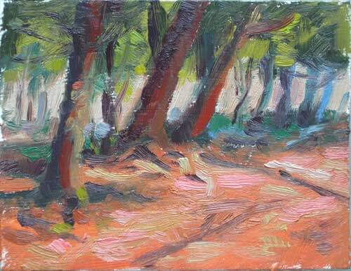 An image of a small painting showing sunlight on a trail leading into the woods.
