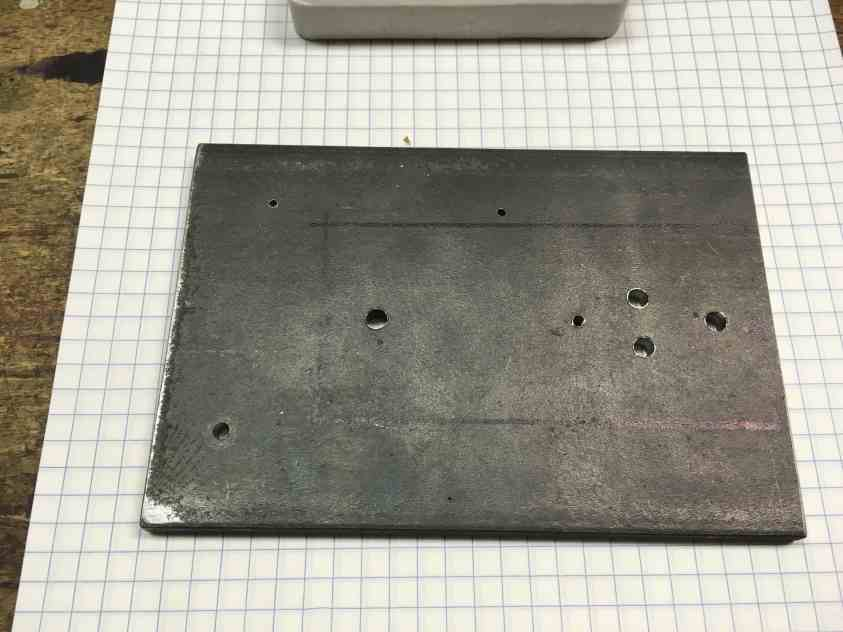 12 steel plate holes drilled