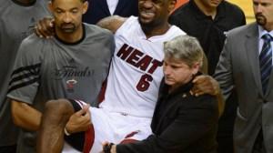 Injured LeBron James of the Miami Heat i