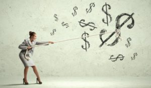 Image of attractive businesswoman pulling rope with dollar symbol