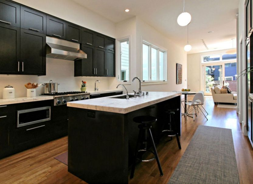 kitchens with black appliances and dark cabinets