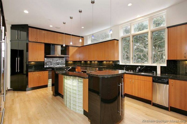 Kitchens with black appliances and glass block construction