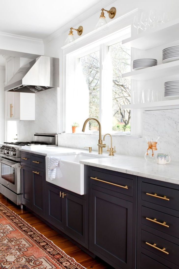 white cabinets with black stainless appliances