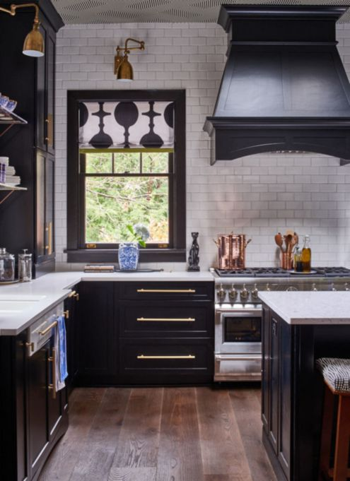 kitchens with dark cabinets and black appliances