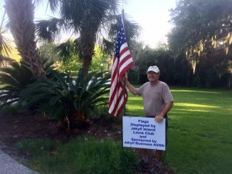 Lion Norm displaying flags in the Historic District.