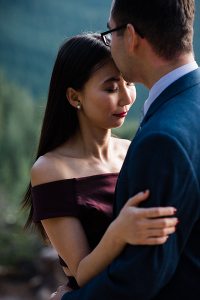 intimate moment during engagement photo shoot in Vancouver
