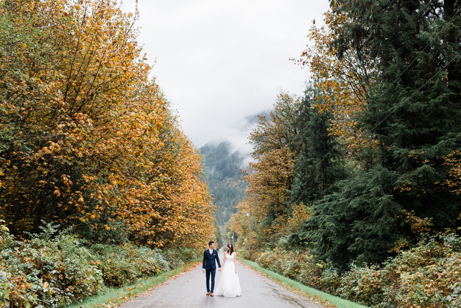 bride and groom walking outdoor at Mission wedding in fall