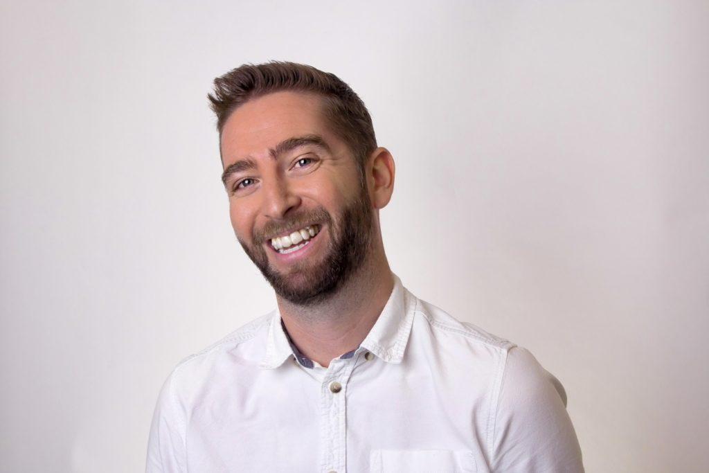 Jemima Willcox Headshot Photographer Cambridge professional image of man in studio laughing