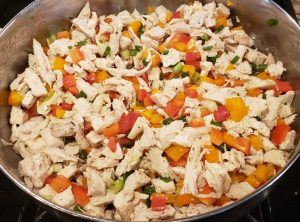 diced chicken, celery, red peppers, orange peppers, and green onions for the buffalo chicken stuffed spaghetti squash