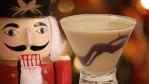 nutcracker martini or a nutcrackertini is a festive holiday martini that consists of vanilla vodka, rumchata, chocolate liqueur, and hazelnut liqueur (frangelico) with a chocolate sauce garnished martini glass.