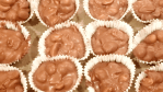 crock pot chocolate covered peanut clusters are an easy homemade candy recipe that make the perfect treat or holiday gift