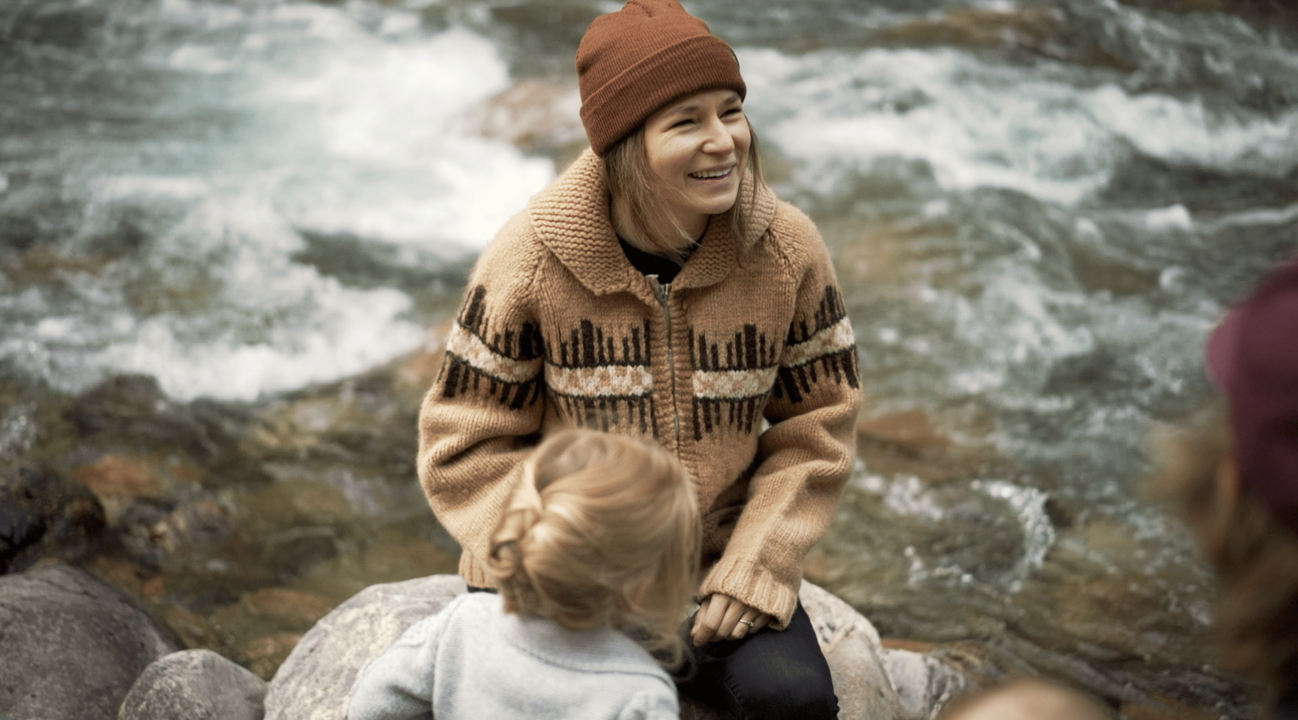 Jena Lee Photographs working with a family for their photography session at a river