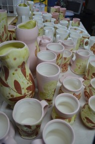 Dipped into glaze and ready for transport to kiln