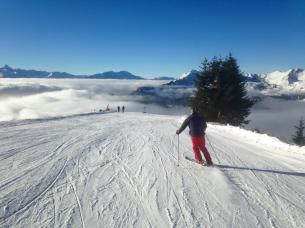 Skiing above the clouds in Les Gets