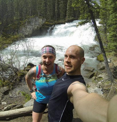 Jamie and Jen in front of waterfall that feeds Upper Kananaskis Lake