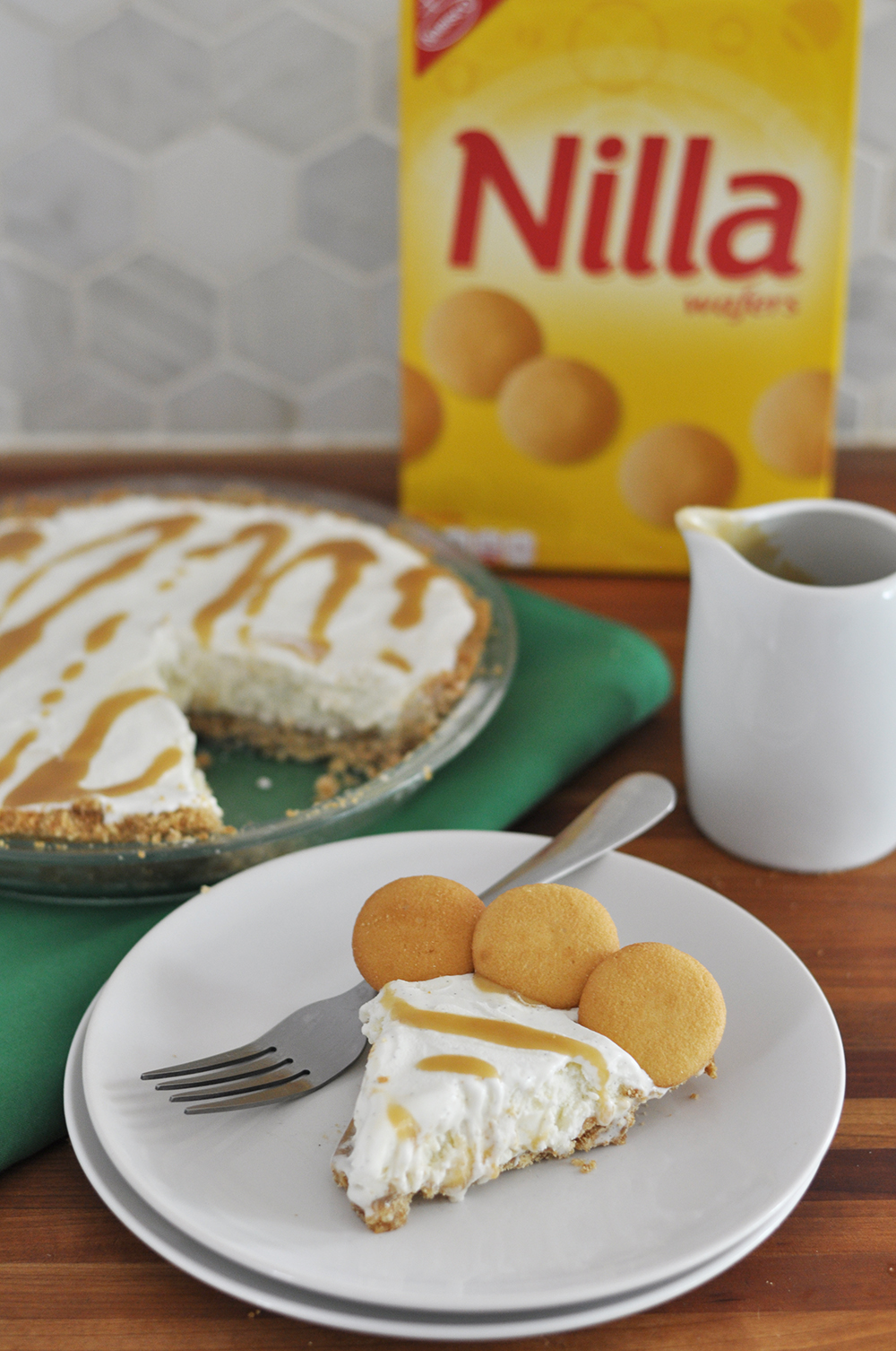 The easiest most decadent pie ever: vanilla ice cream in a NILLA wafer crust drizzled with homemade butterscotch sauce