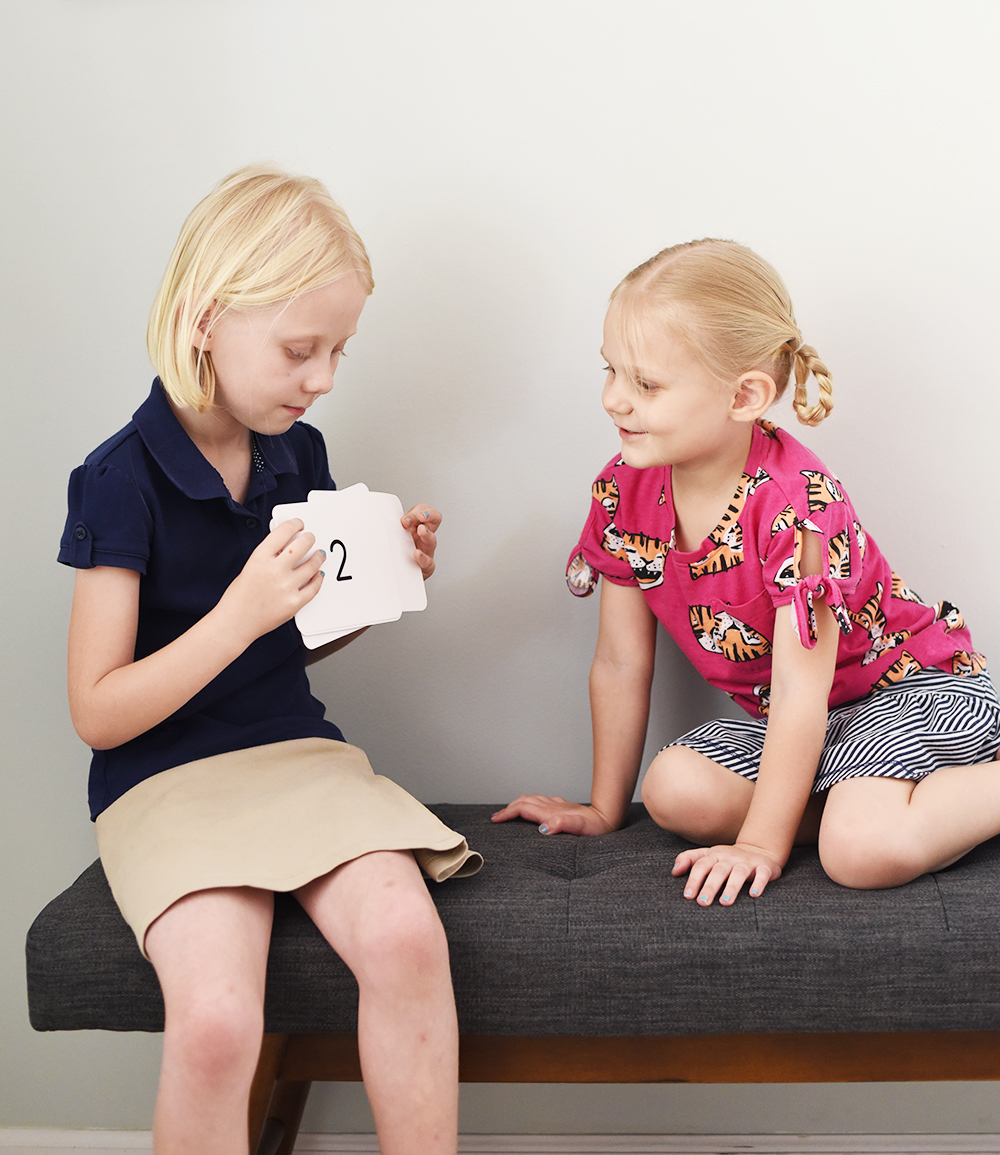 two girls reviewing flash cards