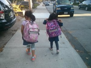 Girls walking to school with backpacks