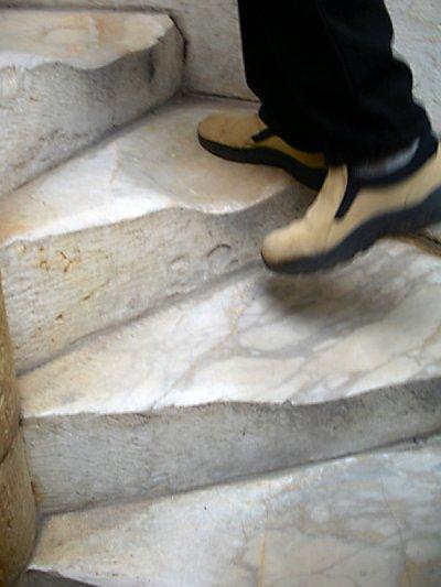 Worn steps under Mike's feet.