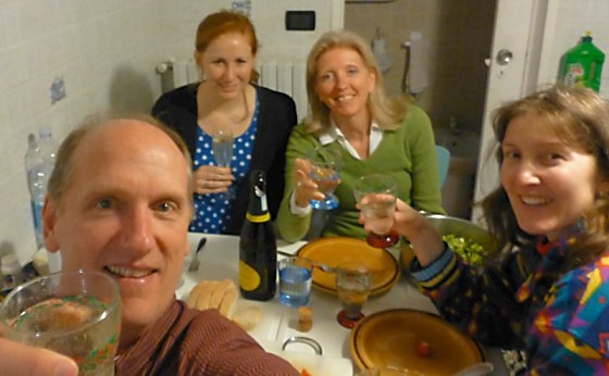 Mike, Lexi, Barb, and Jen toasting dinner and the day.