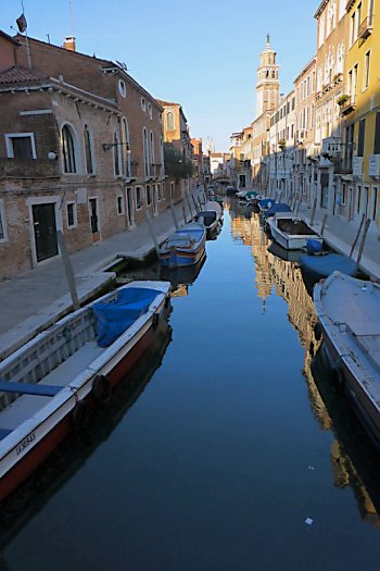 Quiet, still canal in early-morning Venice.