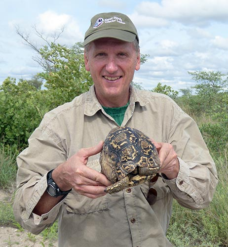 Mike holding a tortoise.