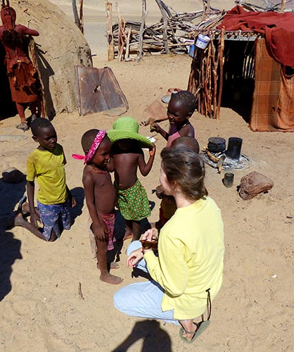 Himba children try on my hat and bandana.