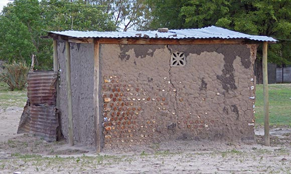 Cans as building materials in Africa.
