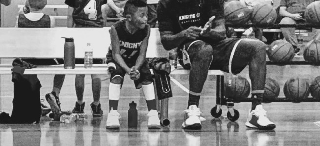 Coach William draws up play for his son