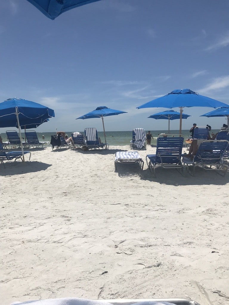 Guest Chairs and Umbrellas on the beach at the JW Marriott Marco Island Beach Resort