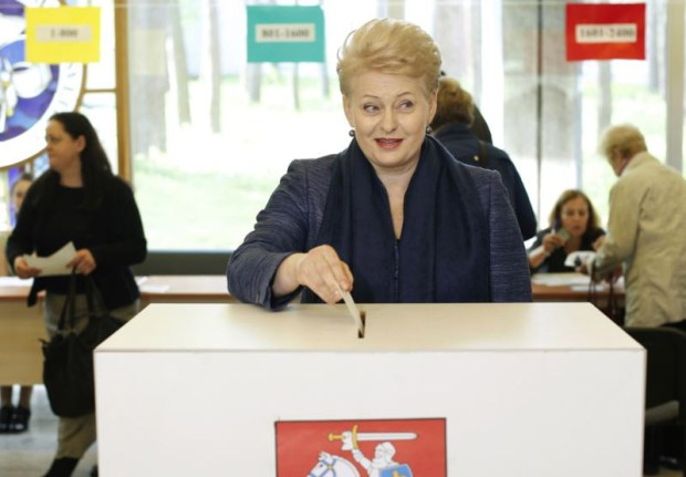 Lithuanian President Dalia Grybauskaitė casts her ballot at a polling station during the first round of voting in presidential election in Vilnius.